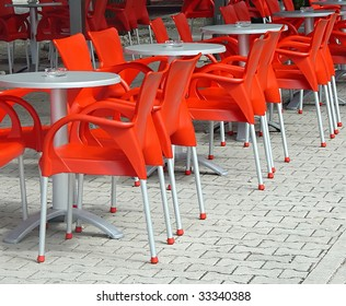 red plastic chairs in free air cafe