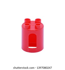 Red plastic construction brick toyisolated on white background