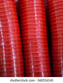 red plastic cups set up tidy. Look like rough tubes