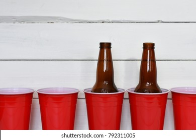 Red Plastic Drinking Cups and Beer Bottles