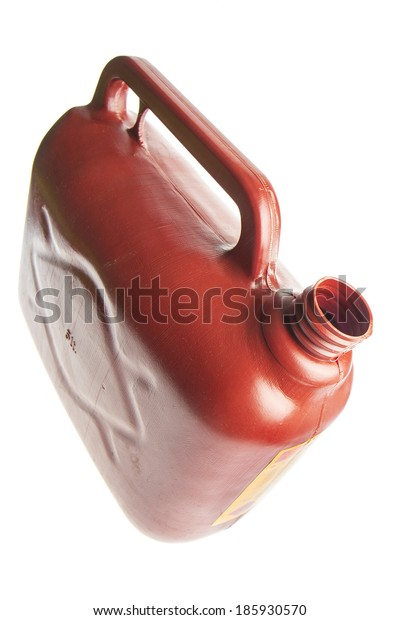 Red plastic gas canister tilted to pour on white background
