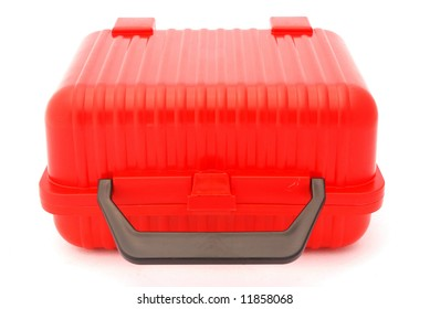 A red plastic lunch box for kids isolated on white background