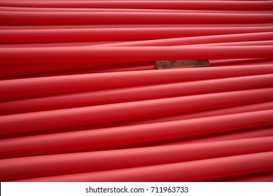 red plastic pipes for building