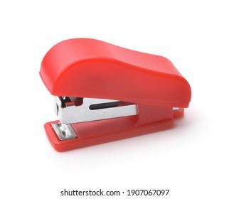 Red plastic stapler isolated on white
