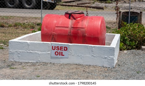 red plastic tank to store used oil from cars and various industrial equipment