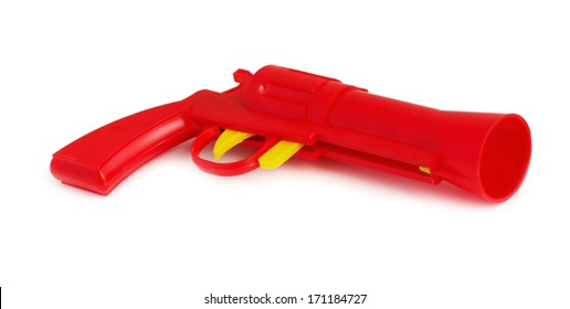Red plastic toy gun isolated on white
