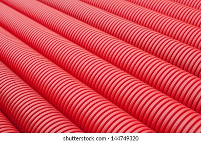 Red plastic tubes in the warehouse.