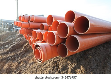red plastic water pipes at a construction site