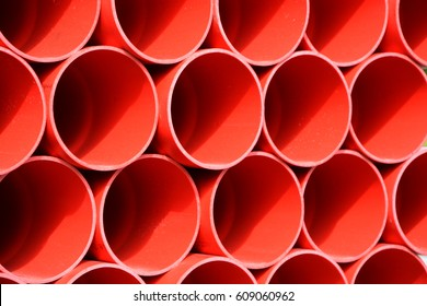 Red Plastic water pipes stacked together