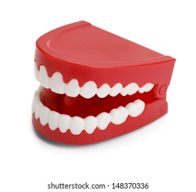 Red Plastic Wind Up Chattering Teeth. Isolated on White Background.