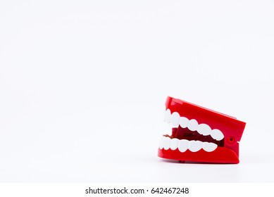 Red Plastic Wind Up Chattering Teeth isolated on White Background
