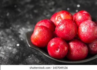 Red plum. Dark background. Healthy diet