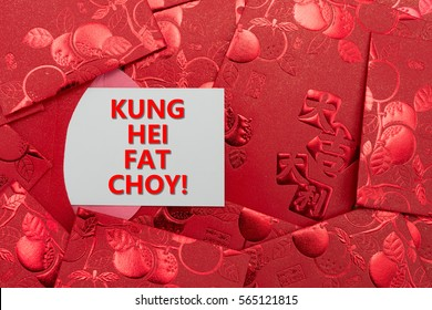 red pockets with a card written kung hei fat choy