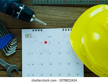 Red point at Labor day holidays on calendar and repair tools on wood table