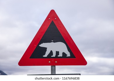 "red polar bear warning sign on Svalbard, located on the road near Longyearbyen. Translation ""Gjelder hele Svalbard"" - valid to whole of Svalbard."