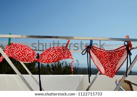 756d9cb123 Red Polka Dot Bikini On Clothesline Stock Photo (Edit Now ...