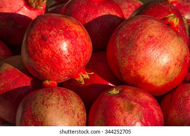 Red pomegranate background. Organic fresh product. Agriculture
