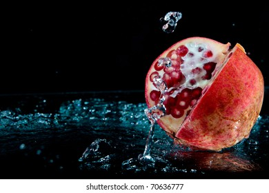 Red pomegranate over black background