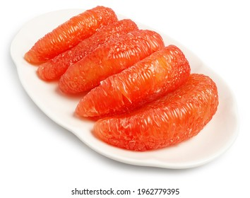 Red Pomelo or Grapefruit called Tabtim Siam in Thai, a sweet taste fruit with bright color planted in Asia, arranged beautifully on a white plate isolated on white background. Clipping path