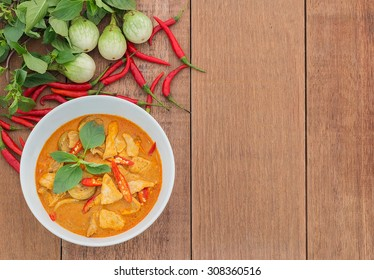 Red pork curry (Panang) with vegetable on wooden background, Thai food