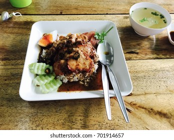 Red pork and Rice on wooden
