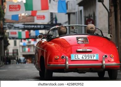 "Red Porsche 1500 back view. The annual rally of vintage cars ""1000 miles"" Brescia-Rome-Brescia May 17, 2016"