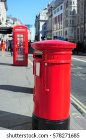 Red post box in England