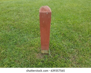 red post on green grass