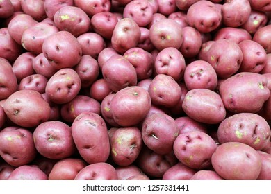 A lot of red potatoes at market place