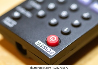 Red power button close-up on DVD/Blu-Ray remote control