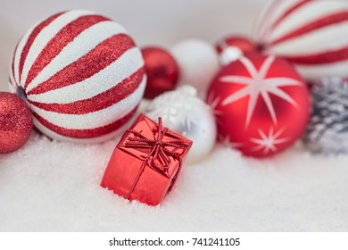 Red present as christmas background with many baubles