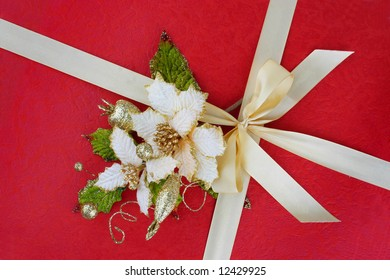 red present paper with gold bow and flowers