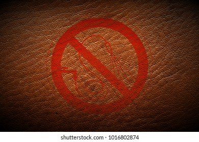 red prohibition stop symbol sign painted on brown leather texture texture background