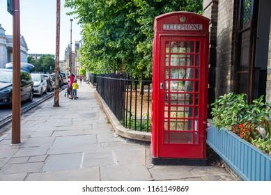 red public phone boots in cambridge, United Kingdom