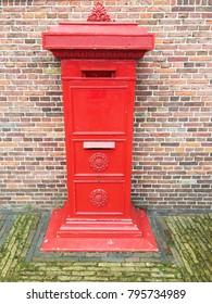 A red public vintage post box