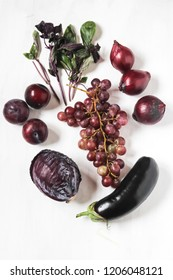 red and purple food on white background