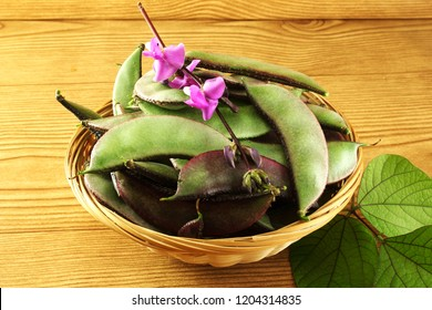 red purple indian surti valor papdi beans,Hyacinth bean,Lablab purpureus with flower and leaves in basket