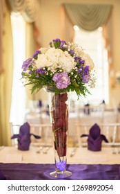 Red and Purple roses floral arrangement centerpiece