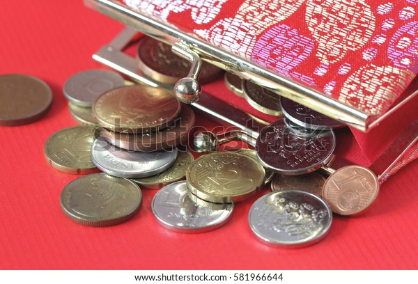 Red purse with different coins