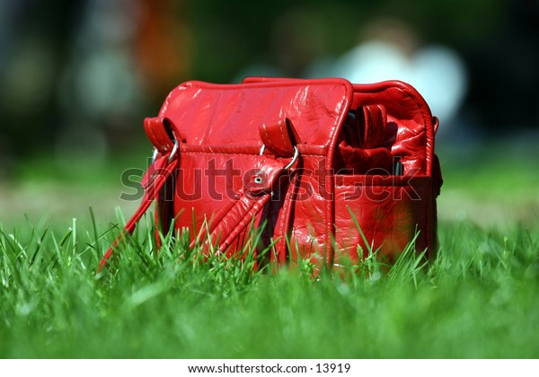 red purse on lawn