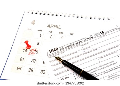 Red pushpin in calendar on 15th April for US tax day