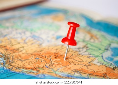 Red pushpin on map on map.Concept of travelling