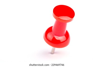 Red pushpin on a white background