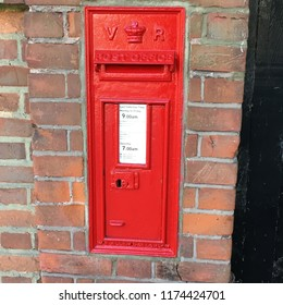 Red Queen Victoria post box, the iconic British public company responsible for providing post office services to the public through its nationwide network of post office branches