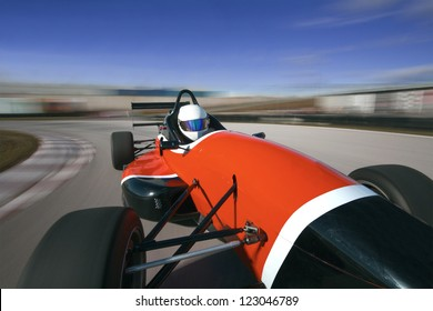 Red Racing Car Driving At High Speed In CircuitCamera On Board