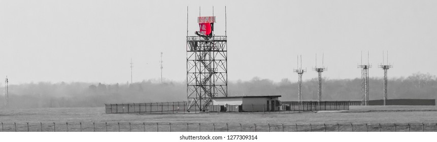 Red radar antenna at an international; airport black and white with selective color red transportation photography