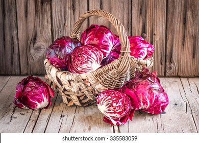 Red radicchio salad on the wooden background