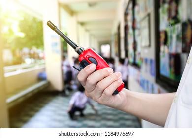 Red radio communication or handheld walkie-talkie.