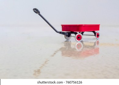 Red radio flyer wagon and reflection