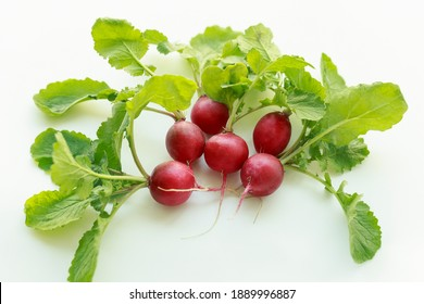 Red radish root and leaves on white background, South Korea